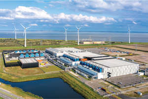 Data center developers must take into account power and water resources when evaluating sites. This aerial view shows the wind turbines near the Google Data Center in Eemshaven, Netherlands. (Image provided courtesy of Google)
